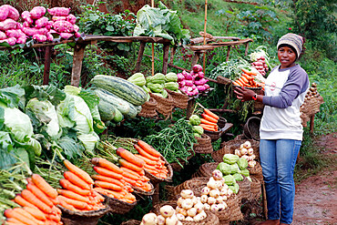 Woman selling fresh vegetables at market, Madagascar, Africa