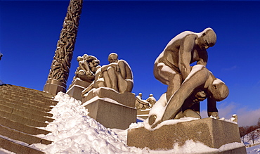 Snow covered statue in winter, Frogner Park (Vigeland's Park), Oslo, Norway, Scandinavia, Europe