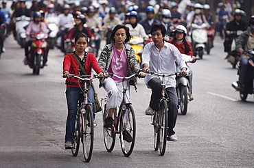 Children on bicycles, Hanoi, Vietnam, Indochina, Southeast Asia, Asia