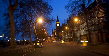 Taxi at dusk on The Embankment approaching The Houses of Parliament with Big Ben in distance, London, England, United Kingdom, Europe