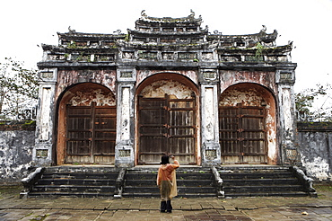Woman taking photo of temple gates, Vietnam, Indochina, Southeast Asia, Asia