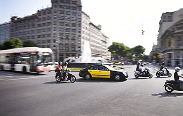 Mopeds, taxi and bus, Barcelona, Catalonia, Spain, Europe