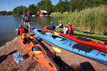 Canoeing along the coasts of the Kobba Klintar island in the Aland archipelago, Finland, Scandinavia, Europe