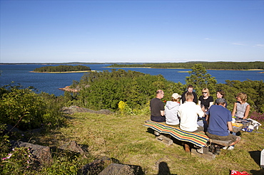 Having a picnic on the cliffside of the Aland archipelago, Finland, Scandinavia, Europe