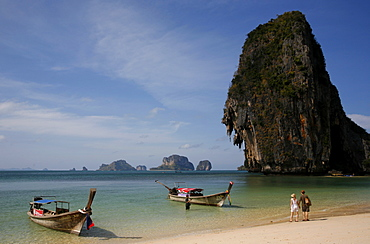 Two long-tail taxis waiting on the beach of Poda island, close to Krabi, Thailand, Southeast Asia, Asia