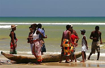 Vezo women buying fish on the beach of Morondava, Madagascar, Africa