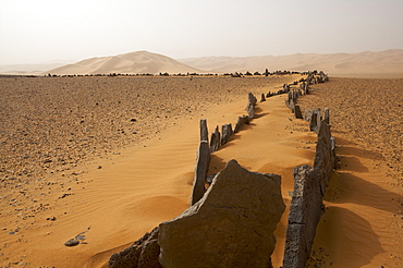 Foundations of an ancient temple on the reg Taita in the Akakus plateau in the Fezzan Desert, Libya, North Africa, Africa