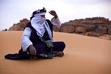 A Tuareg dressed for celebrations at the entrance of the Dar Sahara tented camp in the Fezzan desert, Libya, North Africa, Africa