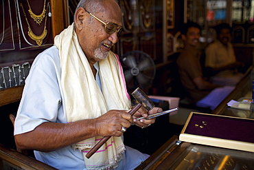 A gold jeweller in a small market in the city of Thuckalay in south Kerala, India, Asia