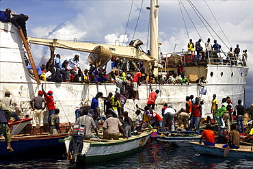 People and goods embarking at the stop-over in a village on Tanzanian side of Lake Tanganyika, Tanzania, East Africa, Africa