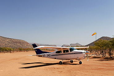 Small Cessna at Kunene River camp, close to Epupa Falls, Namibia, Africa