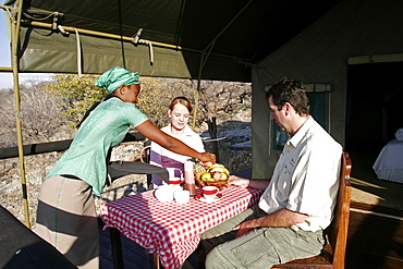 Breakfast on the terrace of a tent in Eagle Tented Camp, close to Etosha and Damaraland, Namibia, Africa
