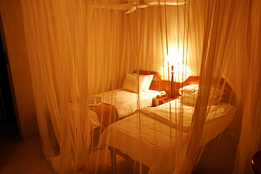 Under the mosquito nets, a room of the Mokuti Lodge, close to Etosha, Namibia, Africa