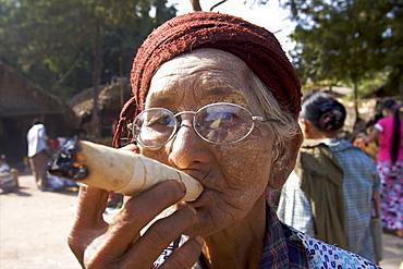 Old woman smoking a cigar, at the market of Bagan, Myanmar (Burma), Asia