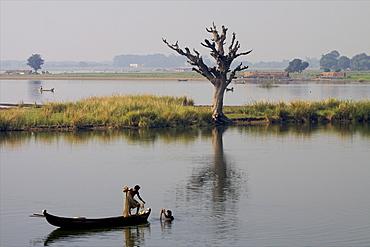 Fishermen on the U Bein lake seen from the teak bridge in Mandalay, Myanmar (Burma), Asia