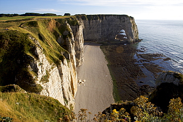 The pebble beach of Etretat and the limestone cliffs of the Cote d'Albatre, Seine Maritime,  Normandy, France, Europe