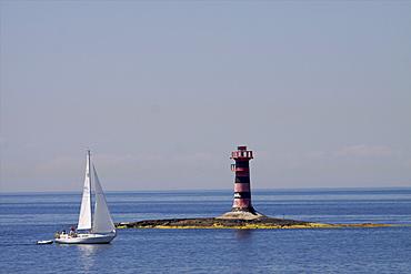 Sailing along the coast of the Kobba Klintar island in the Aland archipelago, Finland, Scandinavia, Europe