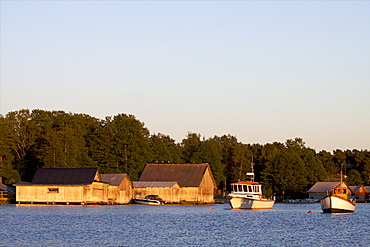 The midnight sun on a small bay of the Aland archipelago, Finland, Scandinavia, Europe