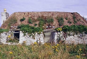 Deserted traditional single-storey croft house, Tiree, Inner Hebrides, Scotland, United Kingdom, Europe