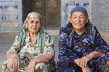 Old traditionally dressed women in the palaces of Khiva, Uzbekistan, Central Asia, Asia
