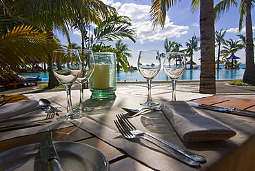 Restaurant table in front of the swimming pool of the Five star hotel Le Paradis, Mauritius, Indian Ocean, Africa