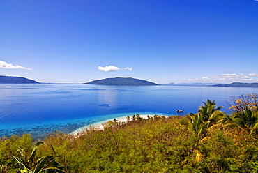 Crystal clear water and white sand beach, in the background Nosy Komab, Nosy Be, Madagascar, Indian Ocean, Africa