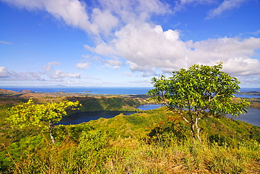Volcanic lake and the coast of Nosy Be from Mont Passot, Madagascar, Indian Ocean, Africa