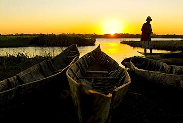Fisherman repairs his net at sunset, Canal des Pangalanes, Mankara, Madagascar, Indian Ocean, Africa