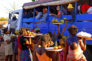 Women selling fruit to people in a local bus, Toliara, Madagascar, Africa