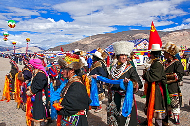 Traditionally dressed Tibetans participating at a local festival, Gerze, Tibet, China, Asia