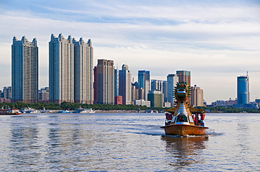 The Songhua River in front of modern office blocks  in the most northern town of Harbin, Dongbei (Manchuria), China, Asia