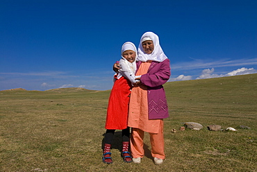 Friendly Nomad mother and daughter, Song Kol, Kyrgyzstan, Central Asia, Asia