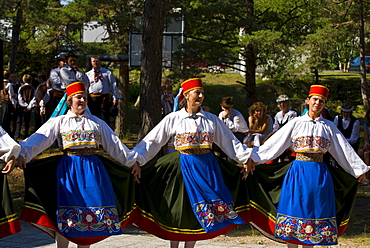 Traditionally dressed women dancing at folk show at Saaremaa Island, Estonia, Baltic States, Europe
