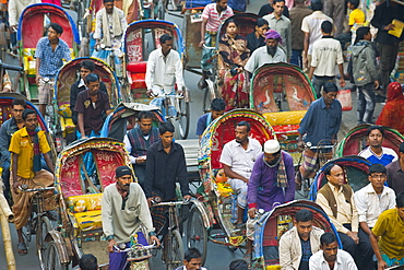 Busy rickshaw traffic on a street crossing in Dhaka, Bangladesh, Asia