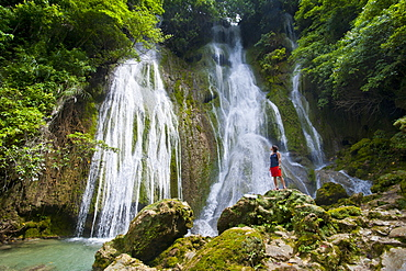 Woman looking at the beautiful Mele-Maat cascades in Port Vila, Island of Efate, Vanuatu, South Pacific, Pacific