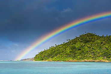 Incredble rainbow over an islet off Ofu Island, Manua Island group, American Samoa, South Pacific, Pacific