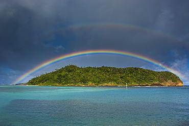 Incredible rainbow over an islet off Ofu Island, Manua Island group, American Samoa, South Pacific, Pacific