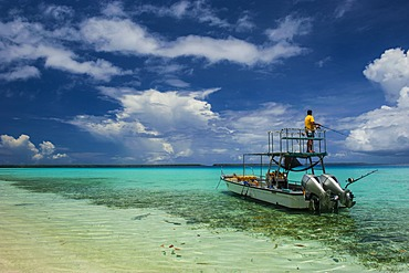 Little motor boat in the turquoise waters of the Ant Atoll, Pohnpei, Micronesia, Pacific