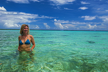 Tourist in the incredible blue waters of the Ant Atoll, Pohnpei, Micronesia, Pacific