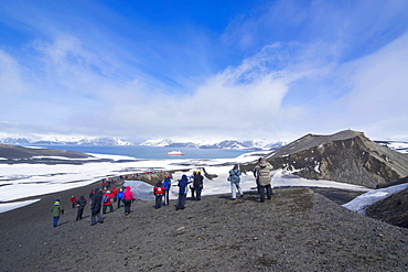 Tourists looking at the Volcano crater at Deception Island, South Shetland Islands, Antarctica, Polar Regions