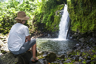 Woman looking at the Nikotoapw waterfall, Pohnpei (Ponape), Federated States of Micronesia, Caroline Islands, Central Pacific, Pacific