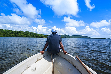 Man sitting on a boat near Nan Madol, Pohnpei Ponape), Federated States of Micronesia, Caroline Islands, Central Pacific, Pacific