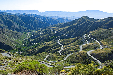 Serpentine bends in road going up the mountain, near Mendoza, Argentina, South America