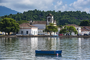 Little boat before a colonial church in Paraty, south of Rio de Janeiro, Brazil, South America