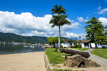 Old cannons on shore of the town of Paraty, Rio de Janeiro, Brazil, South America