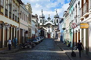 Road with colonial buildings leading to the Nossa Senhora do Carmo church in Sao Joao del Rei, Minas Gerais, Brazil, South America