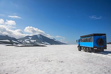 Russian truck crossing a snowfield, Mutnovsky volcano, Kamchatka, Russia, Eurasia