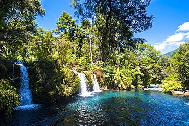 Ojos del Calburga waterfalls near Pucon, southern Chile, South America