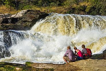 Tourists watching the stunning Murchison Falls (Kabarega Falls), Murchison Falls National Park, Uganda, East Africa, Africa