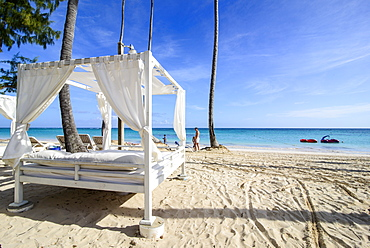 Four poster bed on the beach of Bavaro, Punta Cana, Dominican Republic, West Indies, Caribbean, Central America